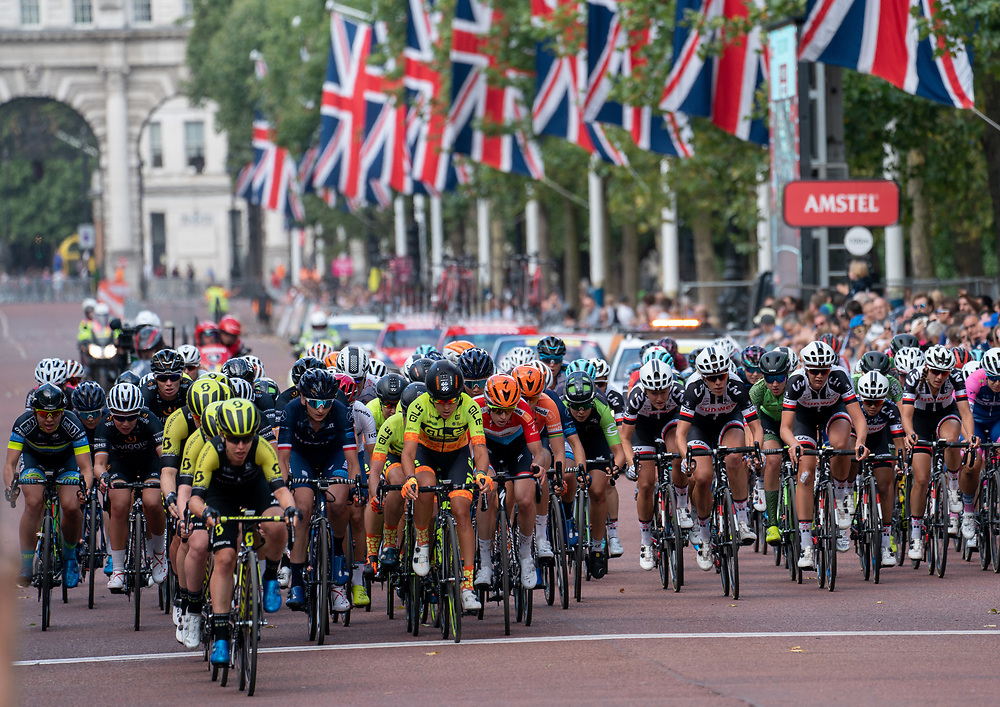 The race crosses the finish line for the final time as they get the bell. The Prudential RideLondon Classique. Saturday 28th July 2018<br /> <br /> Photo: Bob Martin for Prudential RideLondon<br /> <br /> Prudential RideLondon is the world's greatest festival of cycling, involving 100,000+ cyclists - from Olympic champions to a free family fun ride - riding in events over closed roads in London and Surrey over the weekend of 28th and 29th July 2018<br /> <br /> See www.PrudentialRideLondon.co.uk for more.<br /> <br /> For further information: media@londonmarathonevents.co.uk