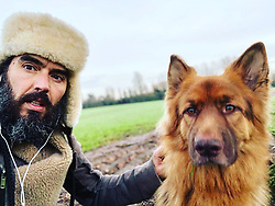 """Russell Brand releases a photo on Twitter with the following caption: """"""""https://t.co/SyZdquFTE4"""""""". Photo Credit: Twitter *** No USA Distribution *** For Editorial Use Only *** Not to be Published in Books or Photo Books ***  Please note: Fees charged by the agency are for the agency's services only, and do not, nor are they intended to, convey to the user any ownership of Copyright or License in the material. The agency does not claim any ownership including but not limited to Copyright or License in the attached material. By publishing this material you expressly agree to indemnify and to hold the agency and its directors, shareholders and employees harmless from any loss, claims, damages, demands, expenses (including legal fees), or any causes of action or allegation against the agency arising out of or connected in any way with publication of the material."""