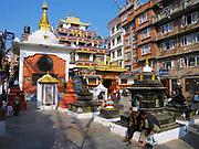 KATHMANDU, NEPAL - NOVEMBER 24, 2005: Stupa and monastery at the historical part of Kathmandu, Nepal.