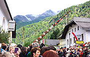 Tilting against the sky of Austria's Lungau, in the Central Alps, prangstangen commemorate the ancestors' hardiness and the virility of today's young men. Oh yes, it's summer solstice and the local saint's day too.