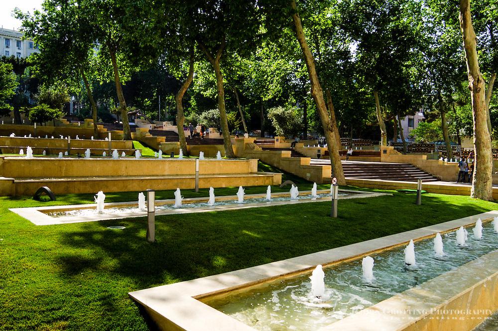 Azerbaijan, Baku. Nizami Park in central Baku with fountains.