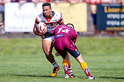 Bradford Bulls prop Jon Magrin (15) is stopped by Batley Bulldogs James Davey (14)  during the Kingstone Press Championship match between Batley Bulldogs and Bradford Bulls at the Fox's Biscuits Stadium, Batley, United Kingdom on 16 July 2017. Photo by Simon Davies.