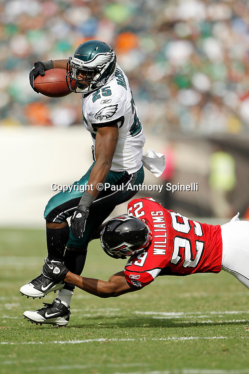 Philadelphia Eagles running back LeSean McCoy (25) gets upended by Atlanta Falcons cornerback Brian Williams (29) during the NFL week 6 football game against the Atlanta Falcons on Sunday, October 17, 2010 in Philadelphia, Pennsylvania. The Eagles won the game 31-17. (©Paul Anthony Spinelli)