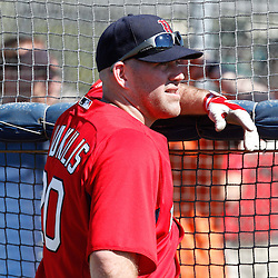 February 19, 2011; Fort Myers, FL, USA; Boston Red Sox first baseman Kevin Youkilis (20) watches batting practice during spring training at the Player Development Complex.  Mandatory Credit: Derick E. Hingle