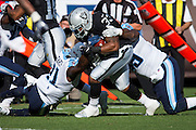 Oakland Raiders running back DeAndre Washington (33) is tackled during a carry against the Tennessee Titans at Oakland Coliseum in Oakland, Calif., on August 26, 2016. (Stan Olszewski/Special to S.F. Examiner)