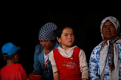 A picture made available on 31 May 2013 of a girl and women of the Uighur ethnic group in Yopurga village of Kashgar, western edge of China's Xinjiang Uighur Autonomous Region, China 25 May 2013. Uighurs, a Muslim ethnic minority group in China, make up about 40 per cent of the 21.8 million people in Xinjiang, a vast, ethnically divided region that borders Pakistan, Afghanistan, Kazakhstan, Kyrgyzstan and Mongolia. Other ethnic minorities living in here include the Han Chinese, Kyrgyz, Mongolian and Tajiks people. In the restive region of Kashgar, western end of Xinjiang where the North and South Silk road meets, Uighurs comprise of more than 90 per cent of the 3.9 million population. Most practice a moderate form of Islam and religion is a major part of most ordinary Uighurs' lives. Tensions have been high between the Uighurs and the dominant Han Chinese as Uighurs complain of cultural and religious repression and claim that Han Chinese migrants enjoy the main benefits of development in the oil-rich but economically backward region.