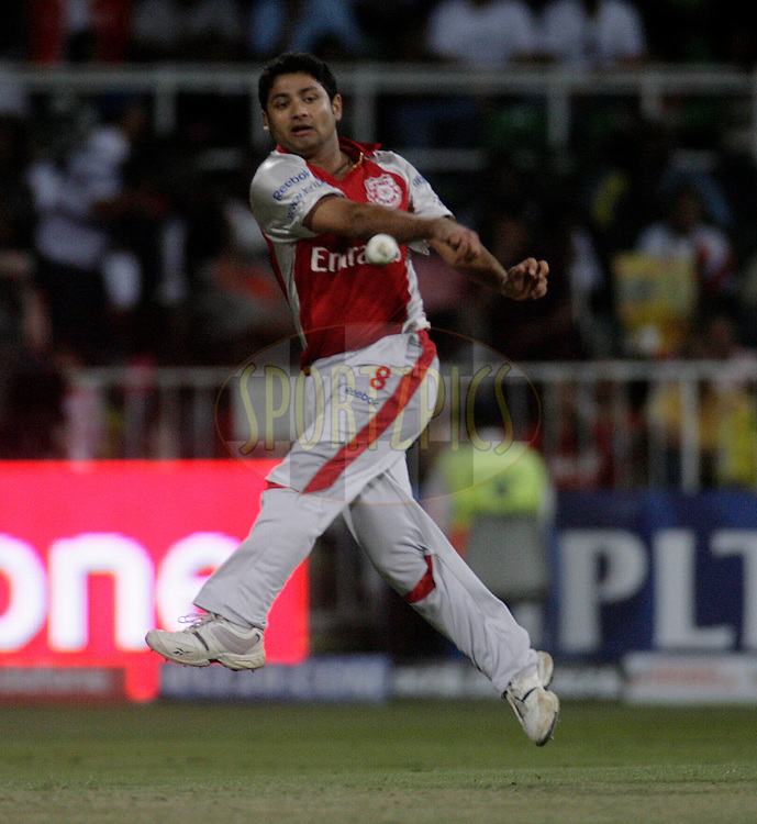 DURBAN, SOUTH AFRICA - 1 May 2009. Piyush Chawla has a throw at the stumps during the IPL Season 2 match between Kings X1 Punjab and the Royal Challengers Bangalore held at Sahara Stadium Kingsmead, Durban, South Africa...