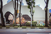 Painters on the Streets of Singapore<br /> <br /> A great new piece by artist Ernest Zacharevic on the streets of Singapore. The artist made several stops in Europe this year with his trademark photo-based murals showing up in Italy, Lithuania and Norway. Zacharevic says of his art:<br /> <br />     Most of my work is photography based and site-specific, so I photograph my subjects and later choose angles for painting. Working with children allows more anonymity, I don't consider my artworks to be portraits of a specific person, rather a universal experience.<br /> ©Ernest Zacharevic/Exclusivepix