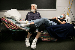September 10, 2017 - St. Petersburg, Florida, U.S. - JOSEPH MCNAMARA and his wife CINDY MACINNIS test on a cot in a hallway at John Hopkins Middle School on Sunday. The school filled classrooms and hallways with  people evacuating before Hurricane Irma makes landfall. The shelter welcomes people from the area with pets and those with special needs. (Credit Image: © Eve Edelheit/Tampa Bay Times via ZUMA Wire)