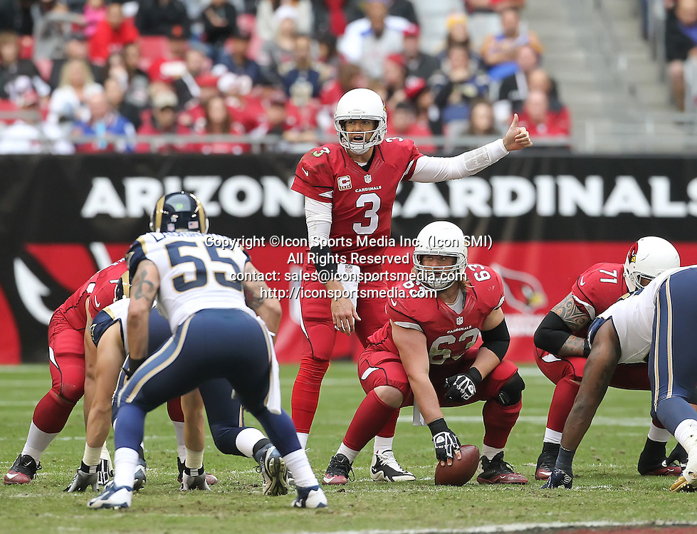 Dec 8 2013: Cardinals QB Carson Palmer (3) calls a play during the Arizona Cardinals hosting the St. Louis Rams game in the University of Phoenix Stadium in Glendale, AZ.  The Cardinals defeat the Rams 30-10.