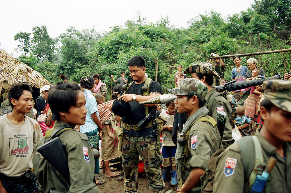 KNLA soldiers on a relief mission in a very remote place in Burma. They bring food, medics and toys for IDPs who try to survive in the jungle. The karen minority in Burma is brutalized by the burmese junta and burmese soldiers. More than 300 000 karens are trying to survive in Burma. They have no medical support, no real education, very few food. The Burmese junta tries to wipe them out of their land. Karen people are victims of an ethnic cleansing and they live in constant fear of anothher attack. The KNLA soldiers are only 7000 to try to protect them.