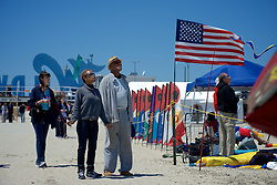 """Wildwoods International Kite Festival, Jersey Shore, NJ USA - May 26, 2013; Jenni Moore and Jasper Stith from Philadelphia look up at the kites in the sky. It is their first time at the event...( Part of a reportage published on WHYY's NewsWorks.org May 29, 2013: """"High flyers compete at Wildwood kite festival"""" - http://shar.es/w02y1 )"""