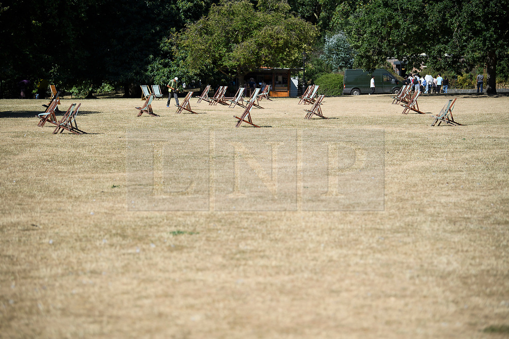 © Licensed to London News Pictures. 23/07/2018. London, UK. Burnt and dry grounds in St James's Park central London, as the hot weather continues in the capital. Forecasters are predicting record temperatures this week. Photo credit: Ben Cawthra/LNP