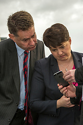 Pictured: Ruth Davidson and Murdo Fraser check twitter reaction to this morning's press release on expansion of the Scottish economy<br />