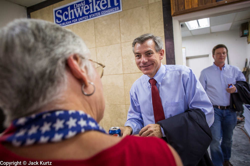28 AUGUST 2012 - PHOENIX, AZ: Rep. DAVID SCHWEIKERT (R-AZ), center, talks to a supporter at Schweikert's victory party Tuesday. Schweikert faced Congressman Ben Quayle in what was the hardest Republican primary election in Arizona in 2012. Both were incumbent Republican freshmen elected to Congress from neighboring districts in 2010. They ended up in the same district at the end of the redistricting process and faced off against each other in the primary to represent Arizona's 6th Congressional District, which is made up of Scottsdale, Paradise Valley and parts of Phoenix. The district is solidly Republican and the winner of the primary is widely expected to win November's general election. Both are conservative Republicans with Tea Party backing.    PHOTO BY JACK KURTZ