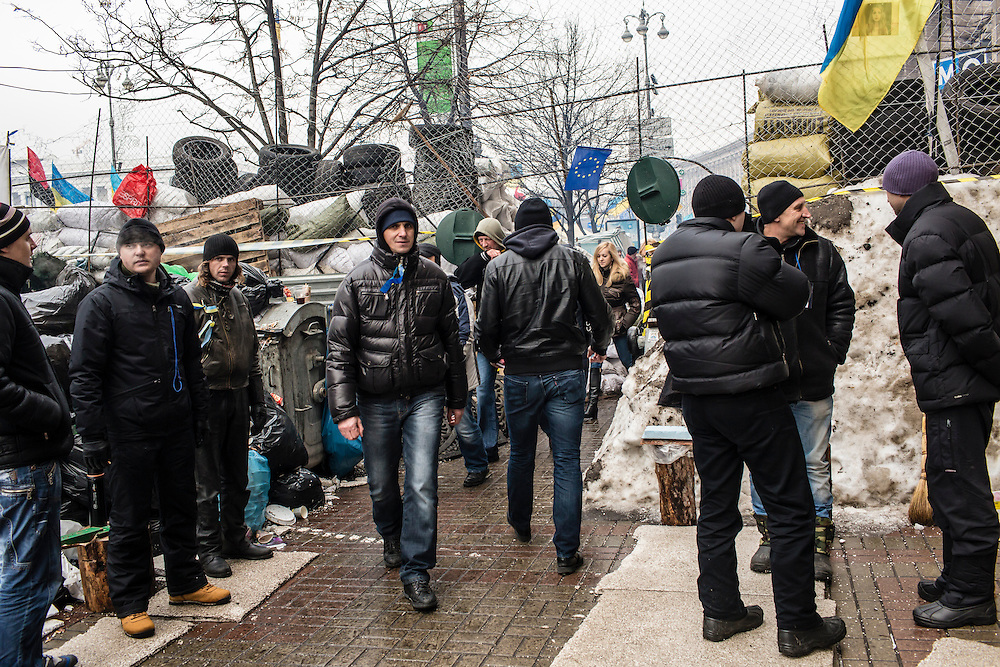 KIEV, UKRAINE - DECEMBER 13: Anti-government protesters stand guard at a control point through one of the barricades restricting access to Independence Square on December 13, 2013 in Kiev, Ukraine. Thousands of people have been protesting against the government since a decision by Ukrainian president Viktor Yanukovych to suspend a trade and partnership agreement with the European Union in favor of incentives from Russia. (Photo by Brendan Hoffman/Getty Images) *** Local Caption ***