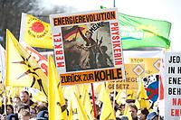 """2012, BERLIN/GERMANY:<br /> Plakat """"Energierevolution - Merkel - Physikerin - Zurueck zur Kohle"""", Kundgebung gegen das Solarausstiegsgesetz und gegen das Scheitern der Energiewende unter dem Motto: """"Stoppt den Solar-Ausstieg"""", vor dem Brandenburger Tor<br /> IMAGE: 20120305-01-004<br /> KEYWORDS: Sonnenenergie, Demo, Demostration, Demonstrant, Demonstratenn, Solarwirtschaft, Subventionen"""