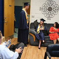 Baldwyn High School seniors Russ Trollinger, center left, and Emily Jenkins, center right, sit in Principal Jeff Palmer's office and talk to math teacher Blair Weaver before the start of Friday night's graduation ceremony at the school.