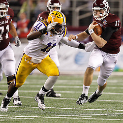 Jan 7, 2011; Arlington, TX, USA; Texas A&M Aggies quarterback Ryan Tannehill (17) runs as LSU Tigers linebacker Kelvin Sheppard (11) pursues during the second half of the 2011 Cotton Bowl at Cowboys Stadium.  Mandatory Credit: Derick E. Hingle