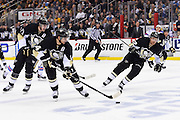 22 April 2015: Pittsburgh Penguins left wing Chris Kunitz (14) carries the puck in to the zone on the power play during the first period of Game Four in the First Round of the 2015 NHL Stanley Cup Playoffs between the New York Rangers and the Pittsburgh Penguins at the Consol Energy Center in Pittsburgh, Pennsylvania.