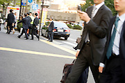 groups of businesspeople rushing to their office Tokyo Marunouchi district