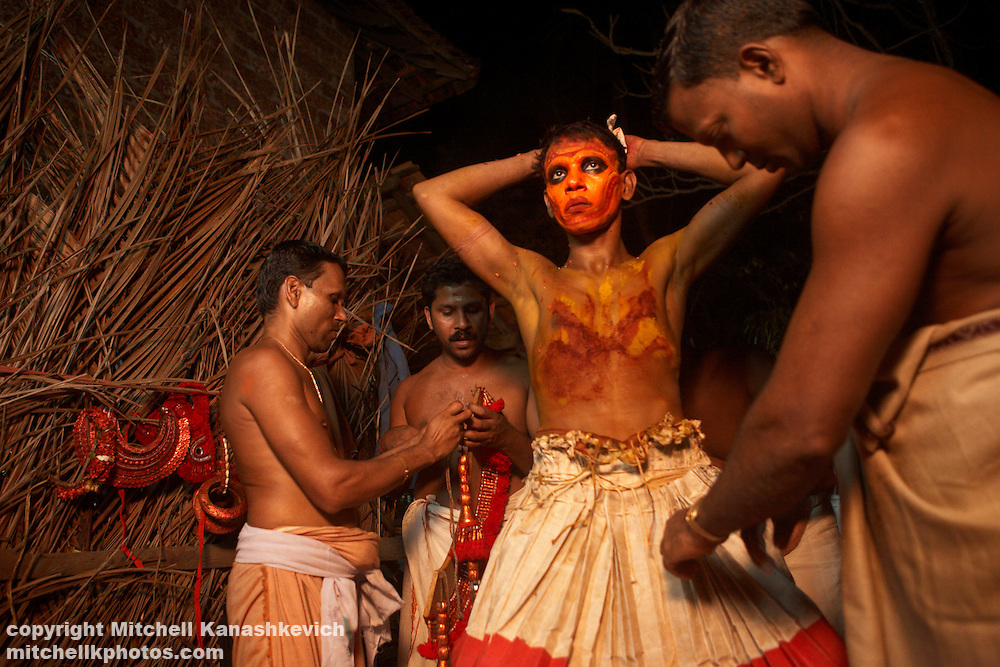 After a Theyyam performance, Kannur District, Kerala, India. .It is believed that while performing; the artist is possessed by a divine spirit and becomes a God - or Theyyam in the local language. In Hinduism there are literally millions of Gods; both good and evil and The four hundred existing variations of Theyyam performances are dedicated to just some of them.