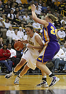 December 22 2010: Iowa center Morgan Johnson (12) drives around Northern Iowa center Lizzie Boeck (20) during the second half of an NCAA college basketball game at Carver-Hawkeye Arena in Iowa City, Iowa on December 22, 2010. Iowa defeated Northern Iowa 75-64.