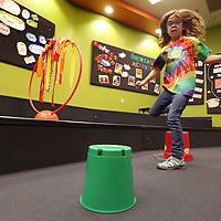 Adam Robison | BUY AT PHOTOS.DJOURNAL.COM<br /> Aiden Cook, 7, jumps over the buckets set up for the trampoline obstacle course at HealthWorks Spring Break Camp Tuesday morning.