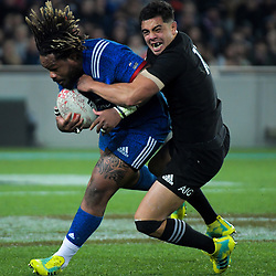 NZ's Anton Lienert-Brown tackles France's Matiieu Bastareaud during the Steinlager Series international rugby match between teh New Zealand All Blacks and France at Eden Park in Auckland, New Zealand on Saturday, 9 June 2018. Photo: Dave Lintott / lintottphoto.co.nz
