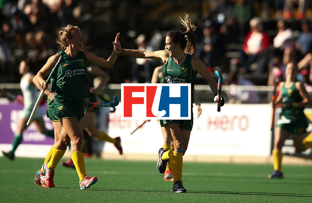 JOHANNESBURG, SOUTH AFRICA - JULY 20:  Lisa-Marie Deetlefs of South Africa celebrates her goal with Celia Evans during the 5th/ 8th place play-off match between South Africa and Ireland at Wits University on July 20, 2017 in Johannesburg, South Africa.  (Photo by Jan Kruger/Getty Images for FIH)