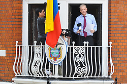 © Licensed to London News Pictures. 19/08/2012. Wikileaks founder Julian Assange speaking from a balcony at The Ecuador Embassy in London on August 19/08/2012. Assange, who faces arrest by British police if he leaves the building, took refuge in the embassy on June 19 to evade extradition to Sweden where he is wanted for questioning over alleged sexual misconduct. Photo credit :  Thomas Campean/LNP