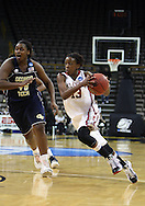 24 MARCH 2009: Oklahoma guard Danielle Robinson (13) drives inside past Georgia Tech center Sasha Goodlett (45) during an NCAA Women's Tournament basketball game Tuesday, March 24, 2009, at Carver-Hawkeye Arena in Iowa City, Iowa. Oklahoma defeated Georgia Tech 69-50.