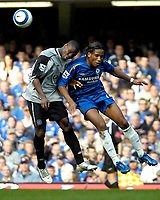 Photo: Ed Godden.<br />Chelsea v Everton. The Barclays Premiership. 17/04/2006.<br />Joseph Yobo (L) and Chelsea's Didier Drogba rise high for the ball.