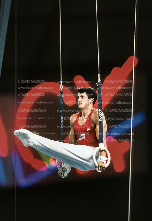 SEATTLE - JULY 1990:  John Roethlisberger of the United States performs on the still rings during the gymnastics competition of the 1990 Goodwill Games held from July 20 - August 5, 1990.  The gymnastics venue was the Tacoma Dome in Tacoma, Washington.  (Photo by David Madison/Getty Images)
