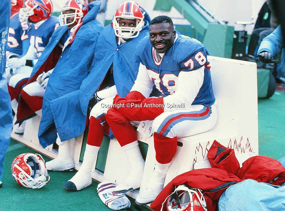 Buffalo Bills defensive end Bruce Smith (78) smiles while sitting on the sideline bench during the NFL football game against the New York Jets on Dec. 23, 1989 in East Rutherford, N.J. The Bills won the game in a 37-0 shutout. (©Paul Anthony Spinelli)
