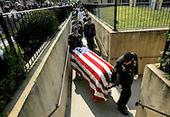 Soldiers carry the casket of Pfc. Le Ron A. Wilson, who was killed in Iraq, into a funeral service in Jamaica, New York.