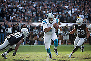 The Oakland Raiders defense chases down Carolina Panthers quarterback Cam Newton (1) at Oakland Coliseum in Oakland, Calif., on November 27, 2016. (Stan Olszewski/Special to S.F. Examiner)