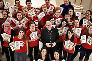 Marty Gervais and class pose after unboxing of two books they produced and published for a University of Windsor Department of English class.