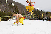 Stunning images show Shirtless Monks Practise Kung Fu On Snowy Mountain