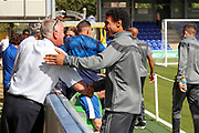 Wycombe Wanderers defender Darius Charles (21) talking with AFC Wimbledon staff during the EFL Sky Bet League 1 match between AFC Wimbledon and Wycombe Wanderers at the Cherry Red Records Stadium, Kingston, England on 31 August 2019.