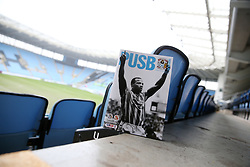 The front cover of the Coventry City programme featuring the late Cyrille Regis before Coventry City's and Swindon Town's match at the Ricoh Arena