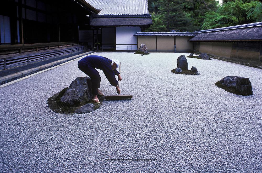 seventeen year old tadaichi iwahashi apprentice monk rakes the zen garden at ryoanji a - Zen Rock Garden