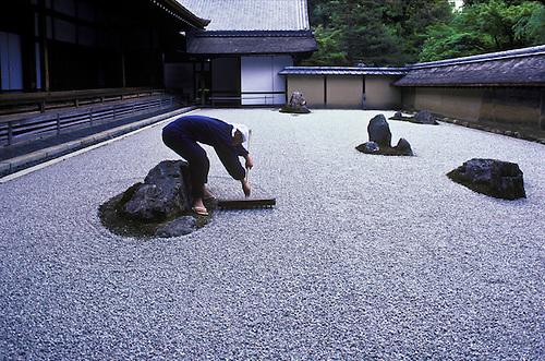 Seventeen Year Old Tadaichi Iwahashi, Apprentice Monk Rakes The Zen Garden  At Ryoanji, A.