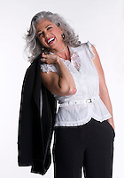 Businesswoman in her 50s laughing very happy, standing isolated.