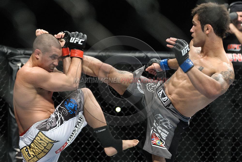 "BIRMINGHAM, ENGLAND, NOVEMBER 5, 2012: Chris Cariaso (left) blocks a kick from Vaughan Lee during ""UFC 138: Munoz vs. Leben"" inside the National Indoor Arena in Birmingham, United Kingdom"