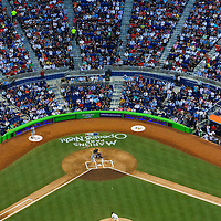 The new baseball stadium glows with downtown Miami in the background for opening night at Miami Marlins Park.
