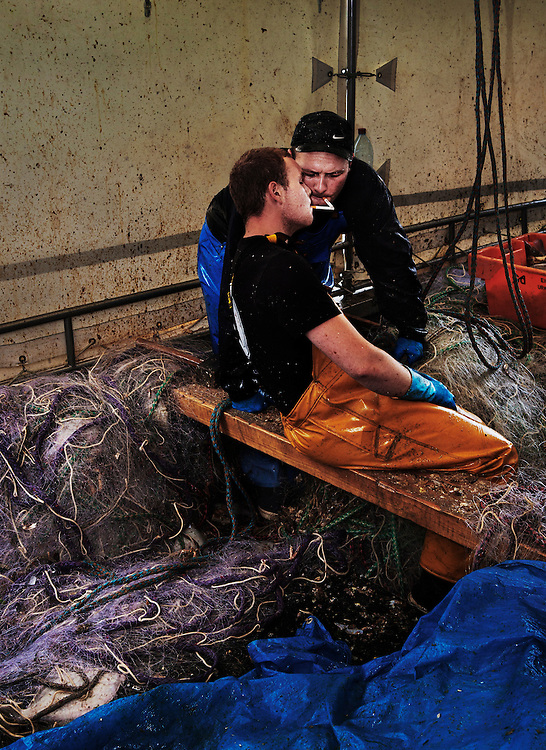 Taking a break from sorting the catch on one of the 65 small-scale fishing boats in the port of Boulogne-sur-Mer, France.<br /> <br /> About 7,000 of the area&rsquo;s residents depend on fishing for their livelihood and approximately 55,000 tons of marine products are landed annually.