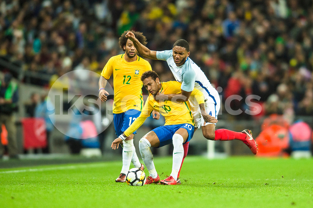Neymar jr of Brazil holds off a challenge from Joe Gomez of England during the international friendly match between England and Brazil at Wembley Stadium, London, England on 14 November 2017. Photo by Darren Musgrove.