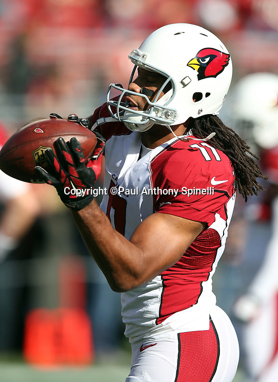 Arizona Cardinals wide receiver Larry Fitzgerald (11) catches a pregame pass before the 2015 week 12 regular season NFL football game against the San Francisco 49ers on Sunday, Nov. 29, 2015 in Santa Clara, Calif. The Cardinals won the game 19-13. (©Paul Anthony Spinelli)