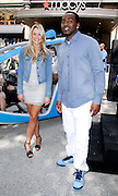 """Katrina Bowden and Hakeem Nicks pose as P&G Launches """"Everyday Effect Campaign"""" in Herald Square in New York City, New York on June 19, 2013."""